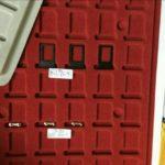 iPhone 7 : photos du tiroir SIM Noir Sidéral et de la carte mère